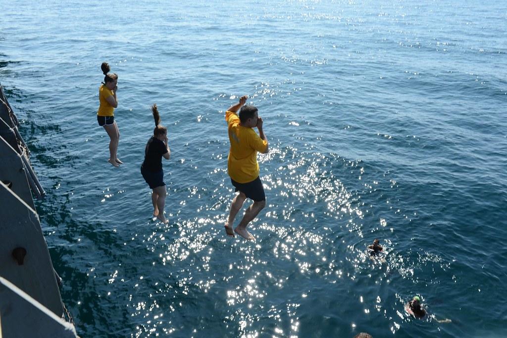 sailors jump off the ship during swim call