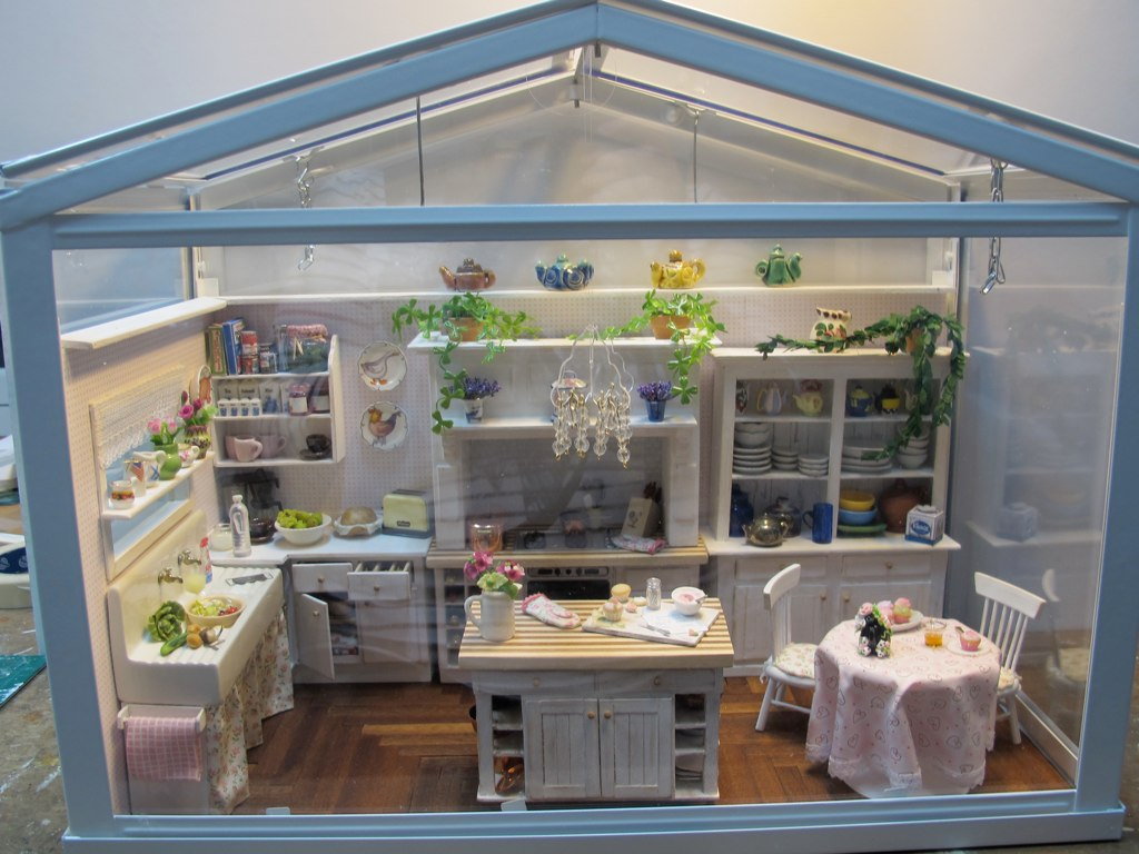 White Kitchen With Green Tile Backsplash