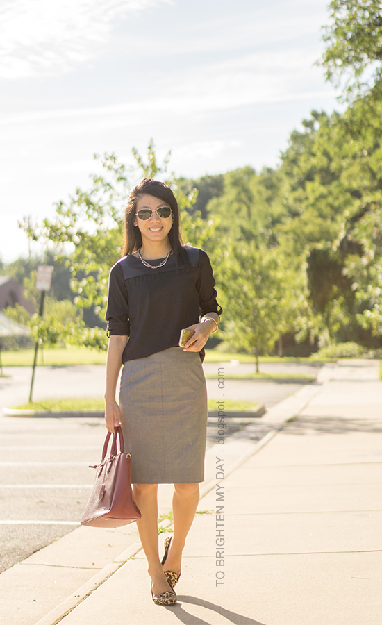 black faux leather yoke top, woven chain necklace, gray pencil skirt, purple red tote, leopard flats