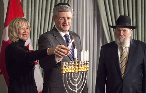 Laureen and I lighting the Menorah at 24 Sussex, as Rabbi Wineberg looks on. | by PM Stephen Harper