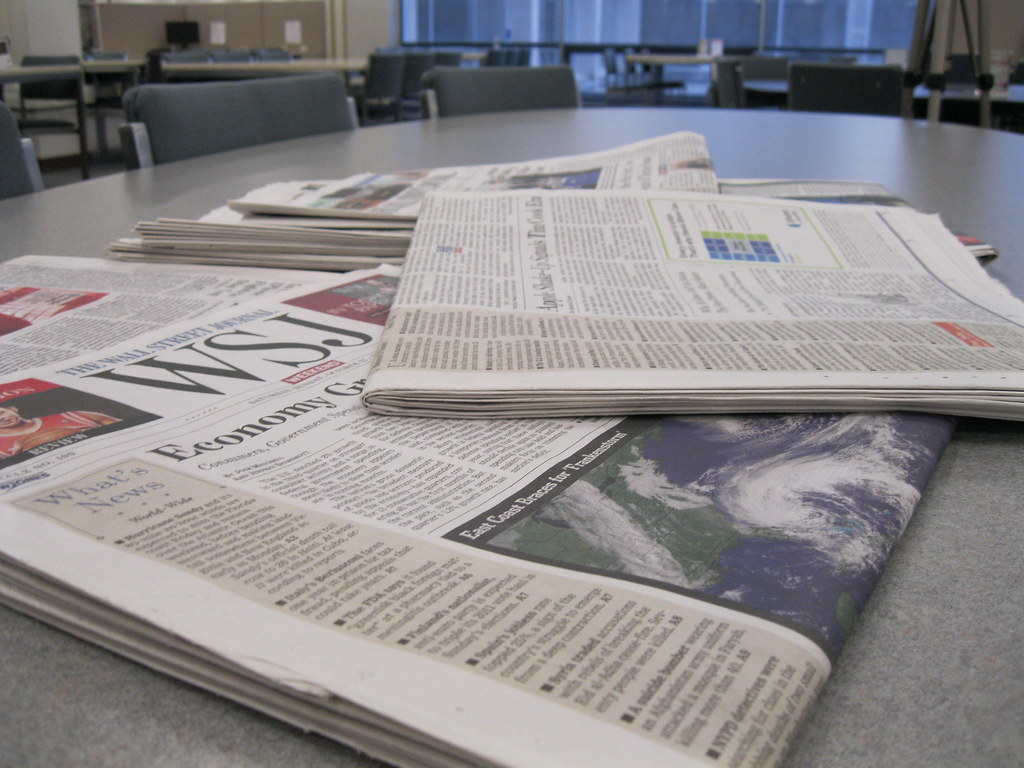 newspapers on a table