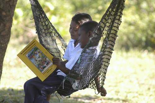 HONDURAS: Two Children Read a Book in a Hammock | by Global Partnership for Education - GPE
