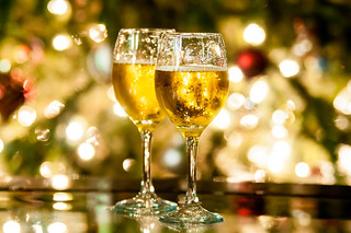 Two champagne glasses ready to bring in the New Year | by DigiDreamGrafix.com