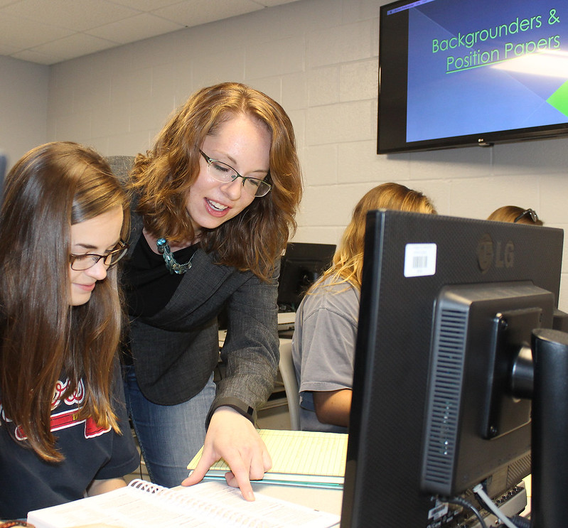 Assistant Professor Diana Sisson works with a public relations student.
