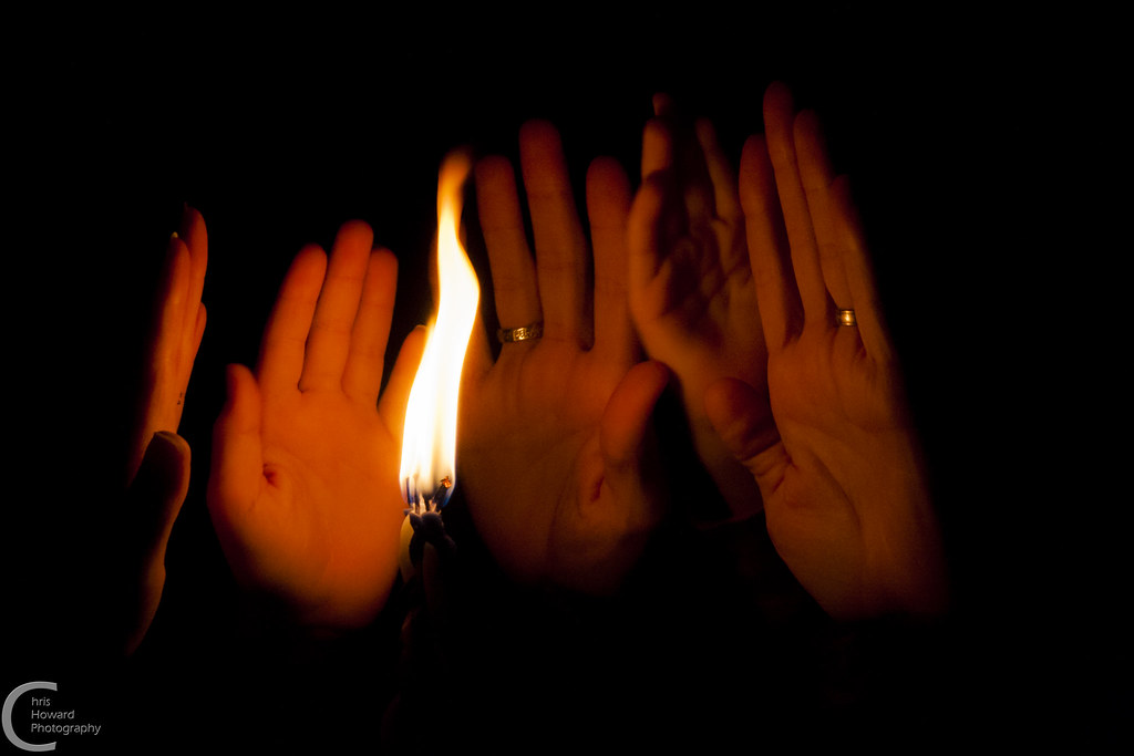 holding hands out to the havdalah candle ברוך אתה ה אלוה flickr