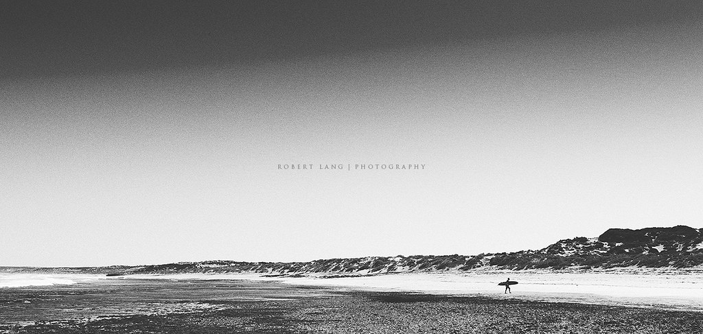 Australian summer surfer on beach vintage black and white by robert lang photography