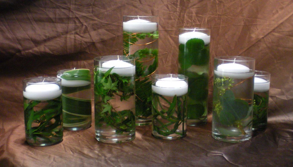 Floating candle greenery centerpiece this simple
