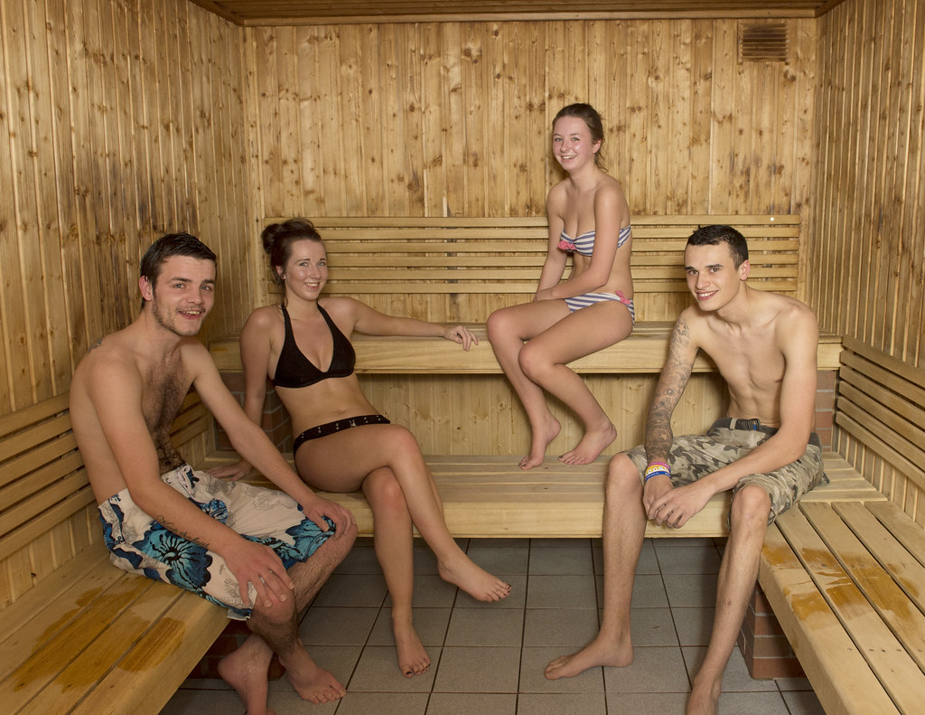 woman with nude men at spa
