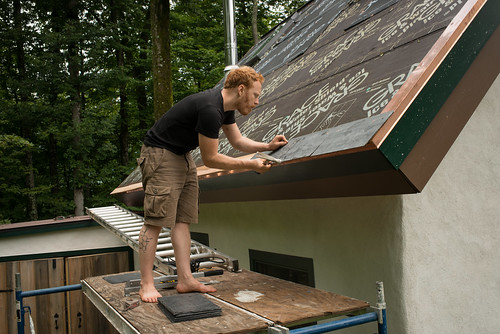 Tyler Affixing Starter Slate to Strawbale Cottage Roof | by goingslowly