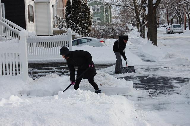 Neighbors shoveling snow