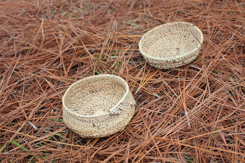 NRCS District Conservationist Andrea Mann, in Oregon, wove these baskets with longleaf pine needles from Mississippi.