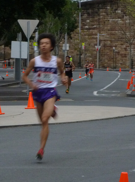 [Leading runner, Japanese teenager Kei Katanishi, goes through the 8 km point of the Blackmore's Half Marathon]
