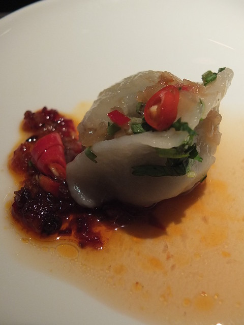 Poached Peking chicken dumpling | Served up with chillis and ...