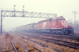 "CNJ 3067 ""Red Baron"" leading ES-98 at Spring St, Feb '76 