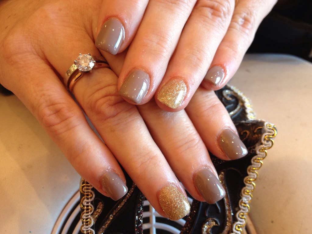 Acrylic nails with wild mink gel polish and gold glitter r ...