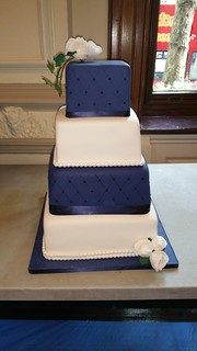 Four tiered navy and white wedding cake. | by platypus1974