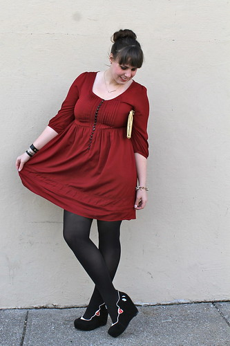 Valentine's Day outfit: red babydoll dress, black opaque tights, face wedges, arrow necklace, vintage gold clutch | by Célèste of Fashion is Evolution