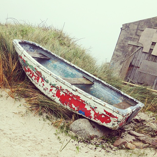 Abandoned Boat And Derelict Building