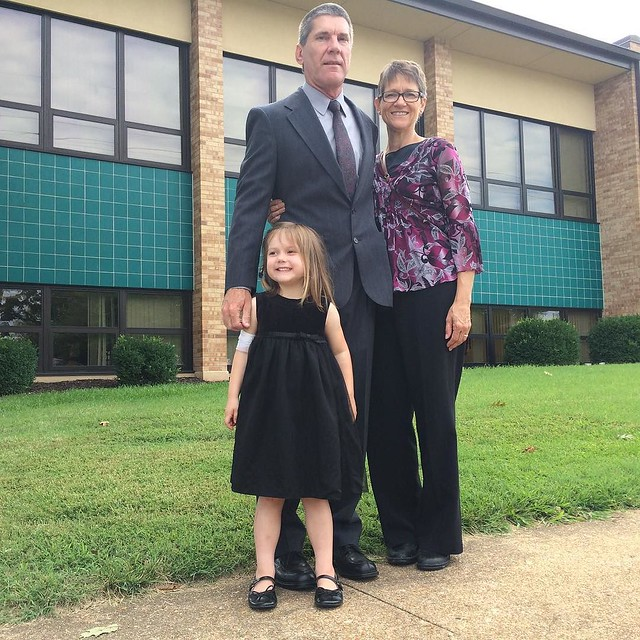 With her grandparents, all dressed up.
