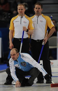 Edmonton Ab.Mar4,2013.Tim Hortons Brier.Quebec skip Jean Michel Menard,Manitoba lead Mark Nichols,second Reid Carruthers.CCA/michael burns photo | by seasonofchampions