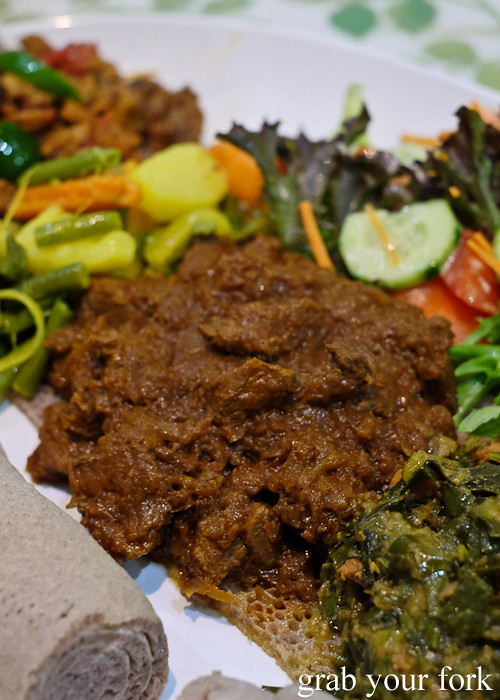 Ethiopian kye sega wot beef simmered in herb infused butter at Aaboll Cafe, Merrylands