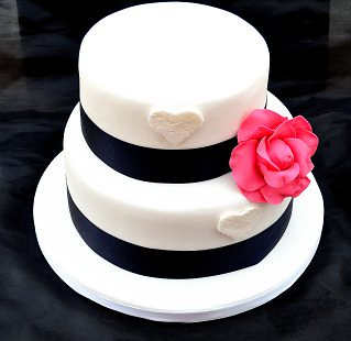Wedding Cake With Lace Hearts Navy Ribbon And Large Pink