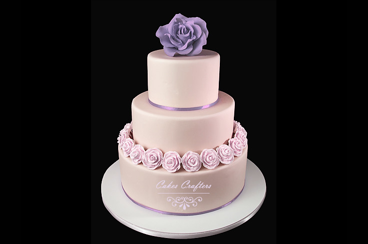 ivory wedding cake with purple roses ivory purple wedding cake with a topper and 16552
