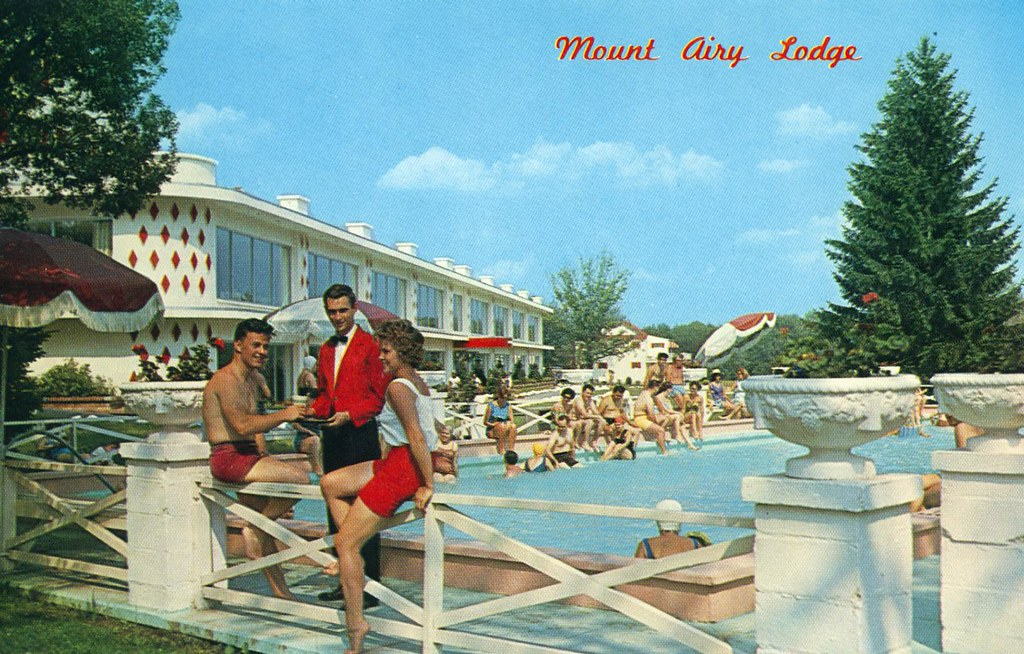 Mount Airy Lodge swimming pool party couple Mt