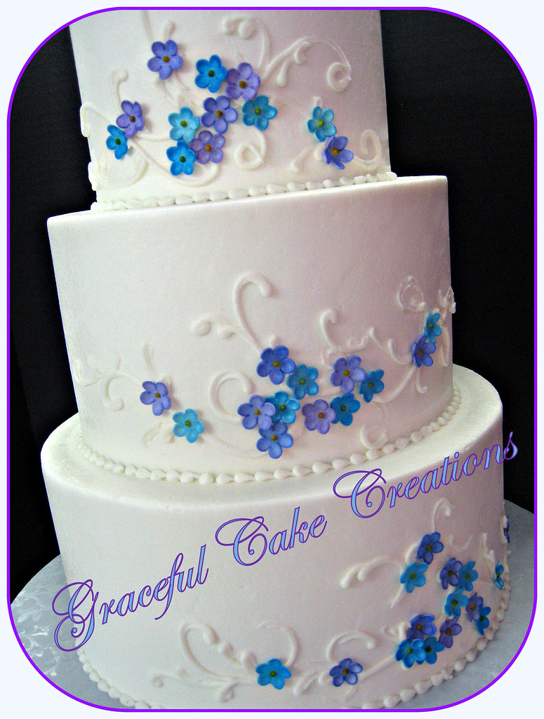 White buttercream wedding cake with purple and blue flower flickr white buttercream wedding cake with purple and blue flowers by graceful cake creations izmirmasajfo
