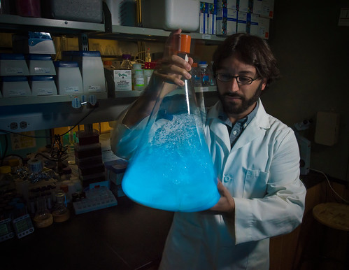 Steven Mansoorabadi, an assistant professor in the Department of Chemistry and Biochemistry at Auburn University, holds bioluminescent dinoflagellates in his lab. | by Auburn University