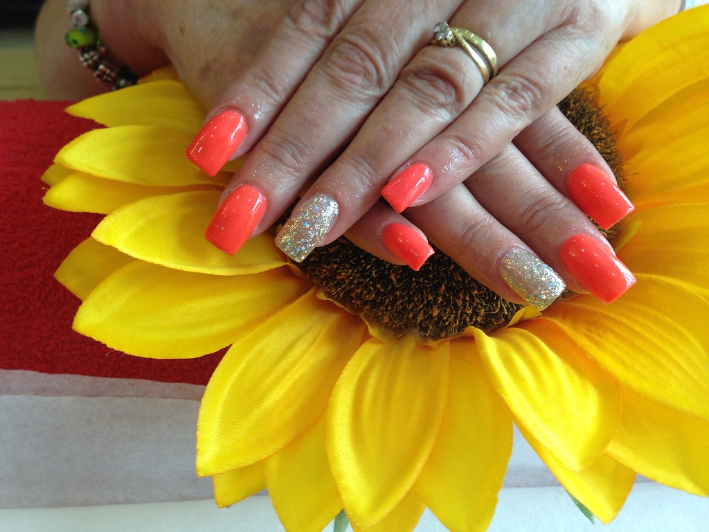 Acrylic Nails With Bright Orange Gelish Gel Polish Silver Glitter On Ring Fingers