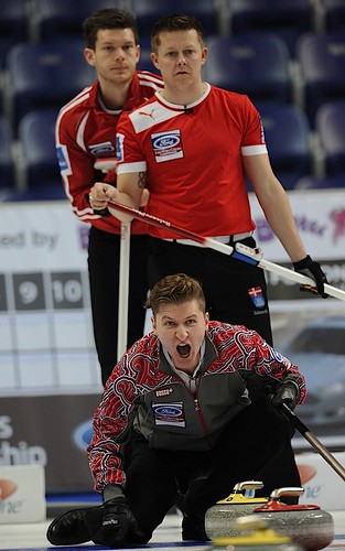 Victoria,B.C. Mar31,2013.Ford Men's World Curling Championship.Russia skip Andrey Drozdov,Denmark skip Rasmus Stjerne.third Johnny Frederiksen.CCA/michael burns photo | by seasonofchampions