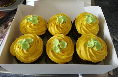 Yellow coloured pipped cupcakes | by platypus1974