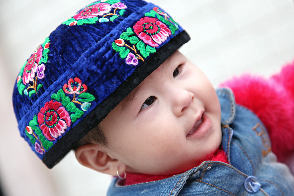 Little Girl Wearing Flower Embroiderd Doppa For Adults Ku