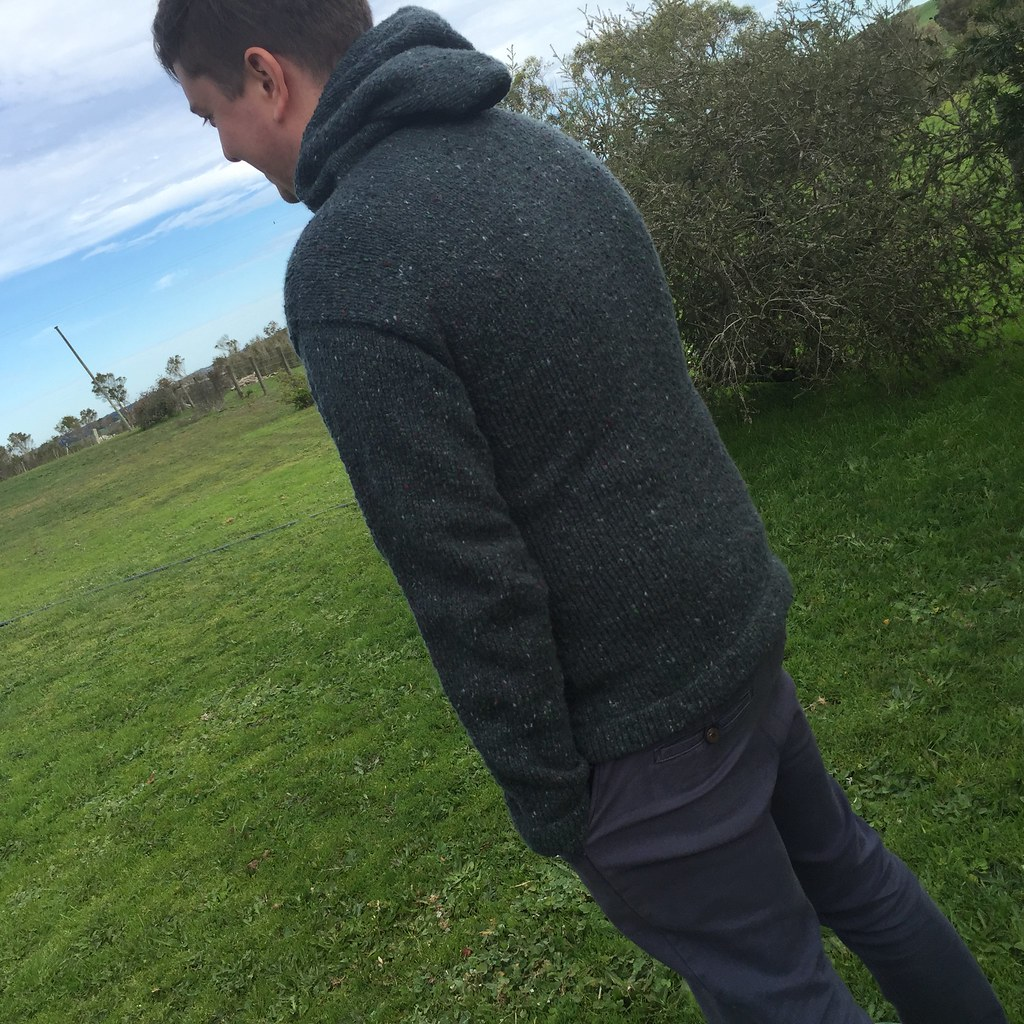 back view of matt's hoodie, knitted in jo sharp aran tweed aran in 'tartan' a dark green colour