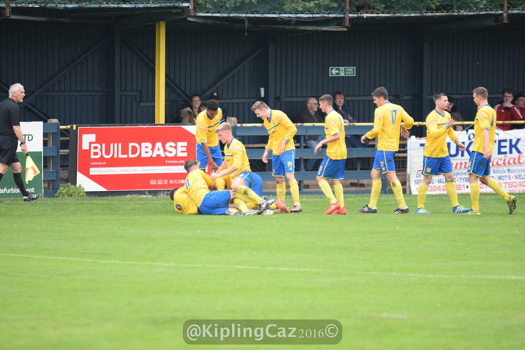 Goalscorer Lewis McPike is at the bottom of the pile