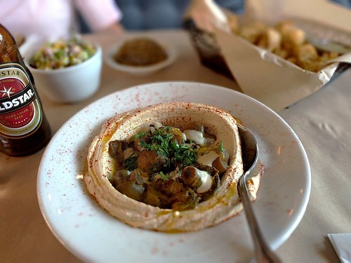 Clockwise from bottom: hummus mushrooms, untraditional tabule, Oren's eggplant, cauliflower fries