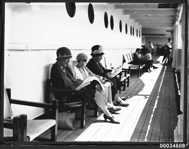 Three women sitting on deck chairs possibly on board SS ORMISTON, 1927-1939