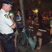 NYPD Dept. Inspector Winski eyeing protester sitting on the ground in Zuccotti Park