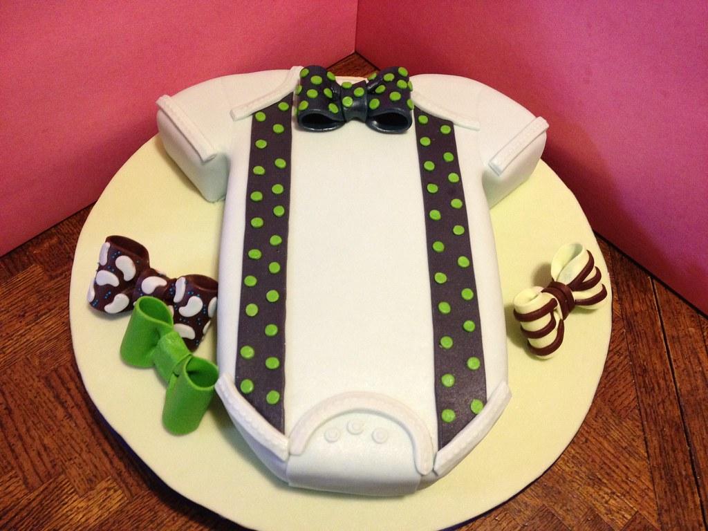 onesie bowtie baby shower cake custom carved into a onesie