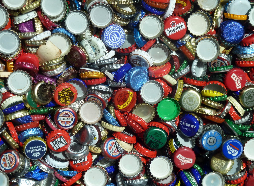 Bottle Tops Seen In The Window Of A Cervezeria At The