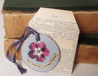 Talisman with flower [my heart lives here] & vintage text envelope - July 2012 | by Mayfifth1935