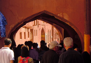 Tourists flock through red gate into Abyaneh rural village - Iran | by Germán Vogel