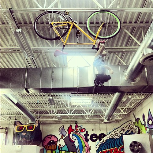 New ceiling mount bike rack 14' up in our atrium. Jen shouldn't mind us testing her bike on it since she's out of town... | by Threadless 365