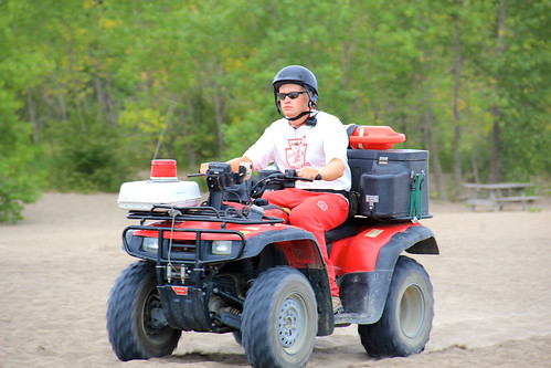 Lifeguard riding ATV on the beaches | by daveynin