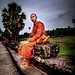 Monk sits in Angkor Wat Temple (Dark Edit) or Light?