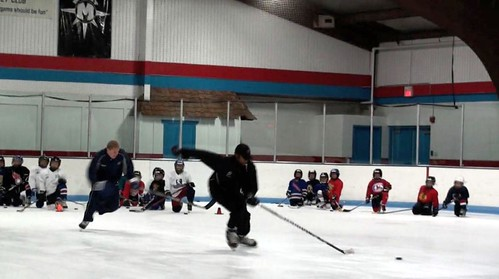 Brad Perry demonstrating hockey quick starts at a hockey camp | by Brad Perry