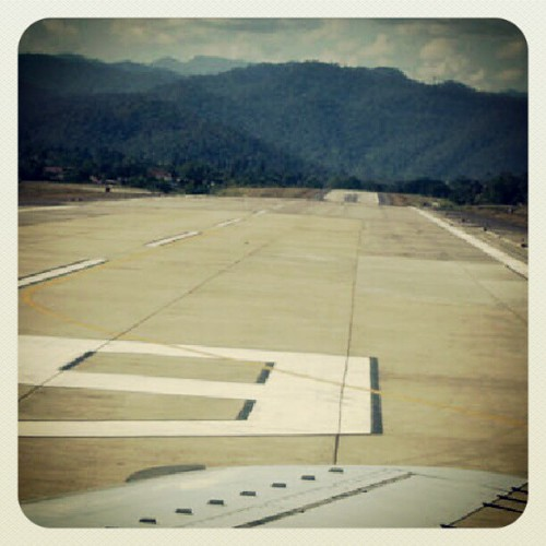 yes, the runway bends downward | by Sarene BKK