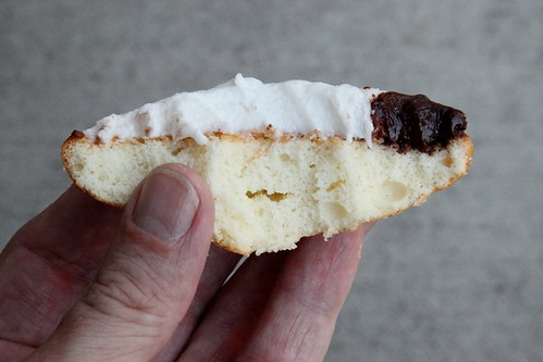 Black-and-white cookie (biteaway view), Leske's Bakery, Bay Ridge, Brooklyn | by Eating In Translation