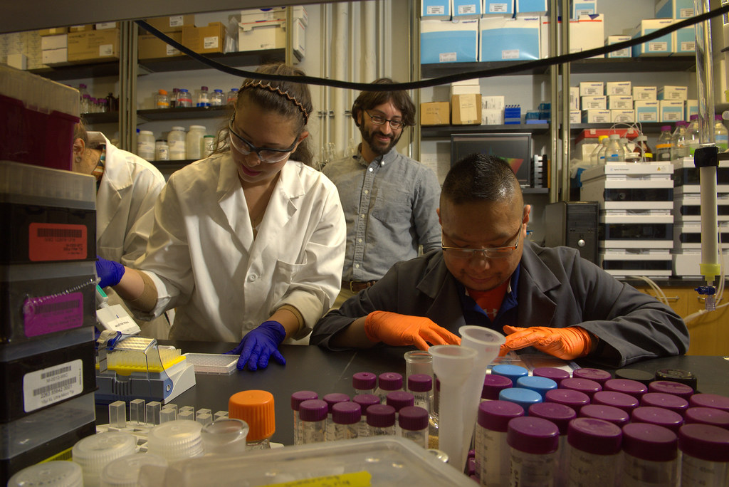 Steven Mansoorabadi, an assistant professor in the Department of Chemistry and Biochemistry at Auburn University, oversees student researchers in his lab.
